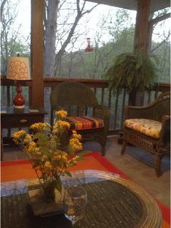 Large screened porch is a great place to relax to the sound of hummingbird wings