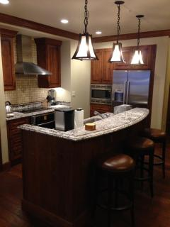 Full kitchen with all amenities Full kitchen including temperature controlled wine storage
