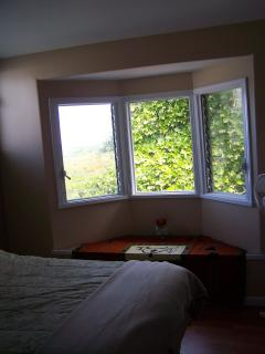 1st guest bedroom,bay window with oceanview