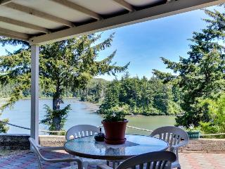Riverfront home with river & ocean access, patio, & fireplace