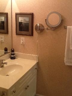Full Guest/Hall Bath off bedroom #1. Lighted mirror, shower with a single sink.