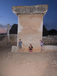 One of Menorca's amazing Taulas ( a massive T-shaped rock monoliths) are fun to visit at sunset