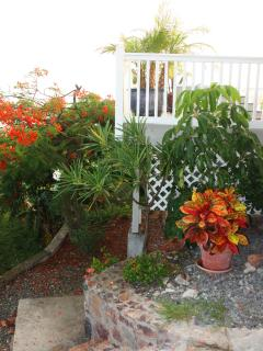 The Private Path to the beach begins at the lower level Patio