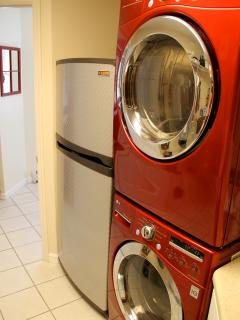 A full laundry room with room for hanging clothes