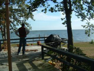 Deck facing the water has view of dock, Rappahannock River, and Chesapeake Bay