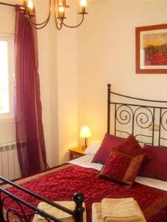 Bedroom 2 (of 3) - The cosy Red Bedroom has a comfortable double bed and captures the morning sun