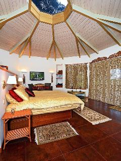 A view of the king size bed with the octagonal skylight above.