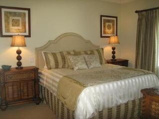 Luxury Master Suite with King-sized bed and private access to 2nd floor balcony