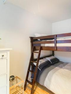 1 semi-closed bedroom with double-double bunk beds.