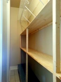 Shelves inside the wardrobe located next to the masterbedroom