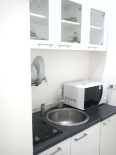 Small kitchen and a microwave.