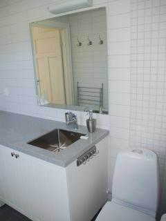 Bathroom with shower, washing machine, floor heating and water toilet