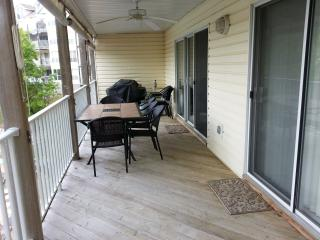Our large balcony: 2 entrances, tile table, gas grill, ceiling fan, sun shades