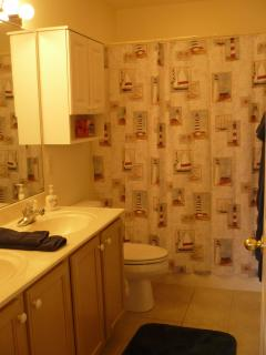 Private master bathroom; tub/shower, double sink
