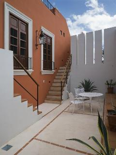 Second floor terrace with stairs to Master Bedroom and Roof Terrace
