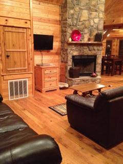 Living room fireplace, flat screen TV, Leather Couches
