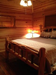 Custom Cedar Log King Size Bed in Master Suite with private bath