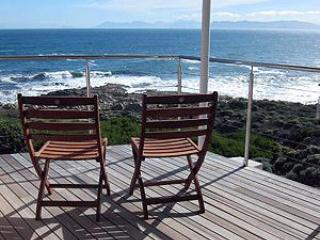 The upper west-facing deck is a perfect spot for whale watching and sundowners.