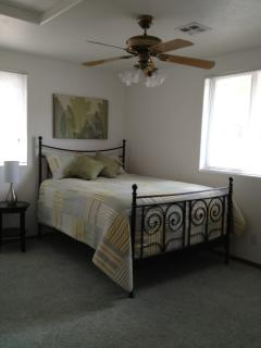 In-law suite - bedroom with queen size bed and satellite TV