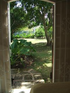 View out back door of apt. into gardens/back yard