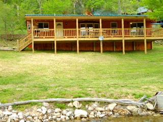 LakeSide Cabin sits right beside the lake, boat slip and canoe, too!