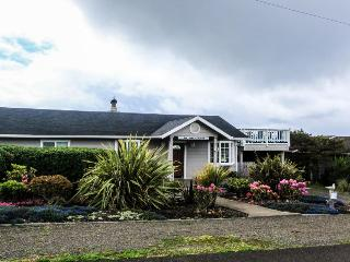 Dog-friendly cottage with beach views, private hot tub, shared pool