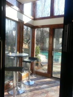 SUN ROOM OVER LOOKS BEAUTIFUL PRIVATELY FENCED YARD WITH IN-GROUND POOL, HOT TUB, AND KOI POND