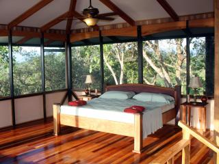Master bedroom features king sized bed, hardwood finishing, 360 views and in suite master bath