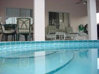 Crystal Clear self cleaning pool and covered lanai with 4 walkouts
