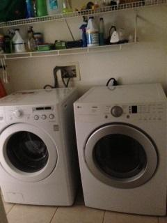 Separate laundry room with new LG front loading inside house