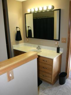 Large 5' vanity with full width mirror highlights the master bathroom