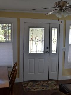 Front door with dining table on left