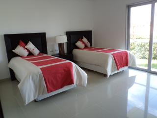 Second Bedroom with private bath, closet and small terrace..