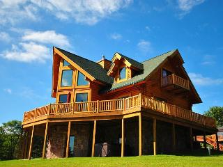 Stunning 5 Bedroom Log Home with hot tub offers breathtaking mountain views!