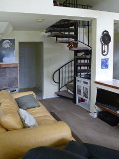 wrought-iron spiral stairs to loft