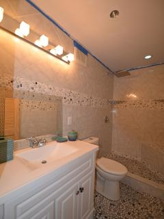 Spa Bathroom Complete With Polished River Rocks On the Walls and on the Floor!