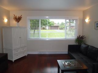 Living Room w large window at front of house