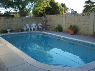 Patio/Pool Area has Unbrella Table & BBQ