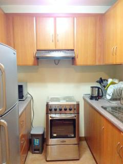 Electric range with hood at the kitchen
