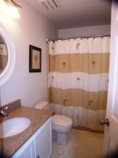 Bathrooms feature granite countertops, tub and shower