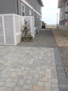 New paved driveways, walkways and side patio with gas grill and outside storage shed