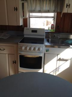 Kitchen with smooth top stove