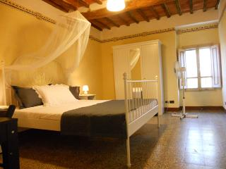Double bedroom with original ceilings and views towards the lake
