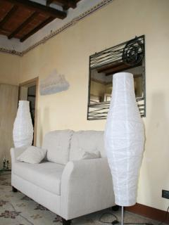 The living area has a sofa and two armchairs, tv, bookcase, internet access.