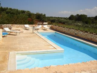 White trullo, villa with pool