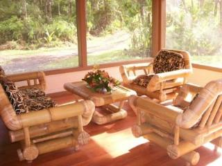 Screened in sitting room lets the fresh air flow, over size bamboo furniture for your comfort