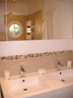 Wonderful shower- large, walk-in, rainhead.  Heated towel bar comes in handy in the spring and fall.  Double sink.