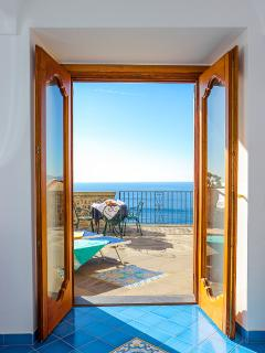 Double bedroom  at Villa Lilmar in Praiano with dircet accss to it beautiful sea view terrace