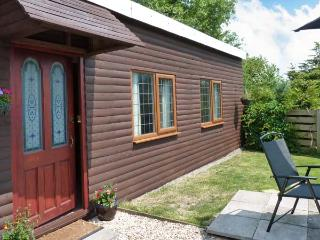 WISTERIA CHALET, detached single-storey cottage, lawned area, parking, near