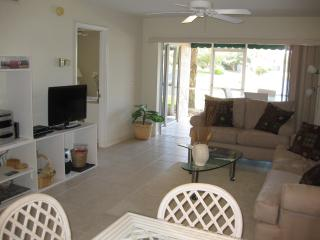 LAKEFRONT CONDO- WALK TO VANDERBILT BEACH - IDEAL!